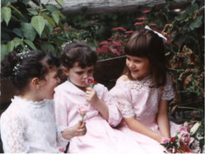 My sister, me, and a cousin at someone's wedding in the early 90s